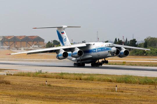 Luqa, Malta - June 6, 2017: Volga-Dnepr Airlines Ilyushin Il-76TD-90VD [RA-76952] landing on a wet runway 13.