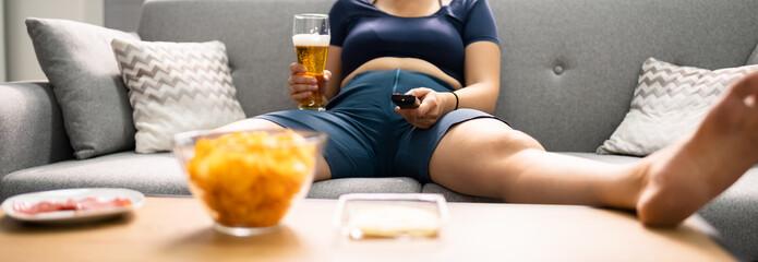 Fototapeta Overeating Junk Food, Drinking Beer obraz