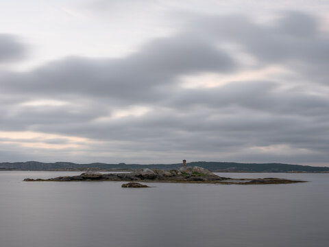 Bare rocks and sea on Sweden west coast shot with long exposure for smooth water surface