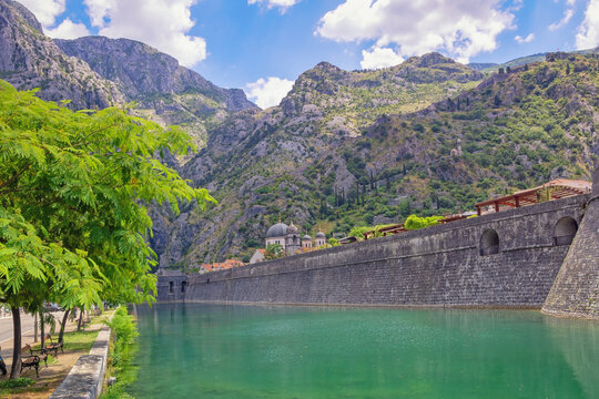 Montenegro, Kotor city.  View of Skurda river and northern walls of  Old Town of Kotor on summer day