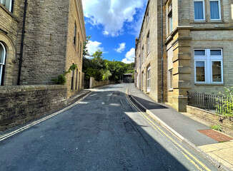Looking up, Rise Lane with stone Victorian buildings in the centre of, Todmorden, Yorkshire, UK