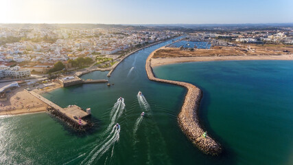 Aerial view from the sky of the Portuguese coastline of the Algarve zone of Lagos city. Boats and...