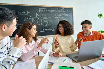 Four diverse multiracial young happy colleagues students business startup gen z team discussing...