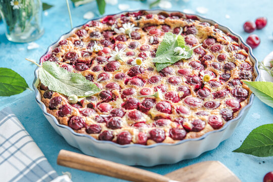 cherry Clafoutis with cherry on a blue  background