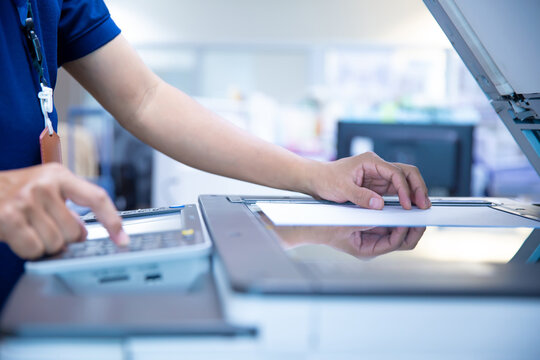 Copier printer, Close up hand office man press copy button on panel to using the copier or photocopier machine for scanning document printing a sheet paper and xerox photocopy.