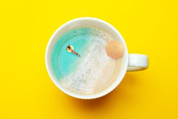 Woman swim in coffee mug with sea vacation concept