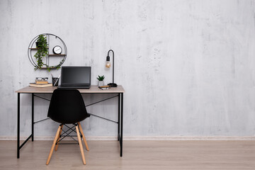Workplace with laptop in office or home