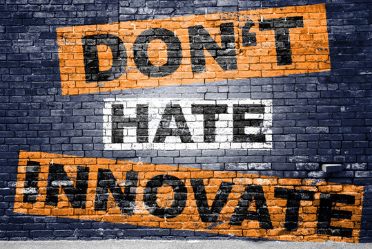 don't hate innovate saying lettering Graffiti on Brick Wall