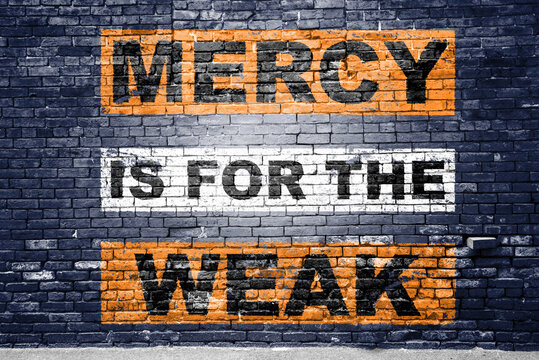 Mercy is for the weak saying lettering Graffiti on Brick Wall