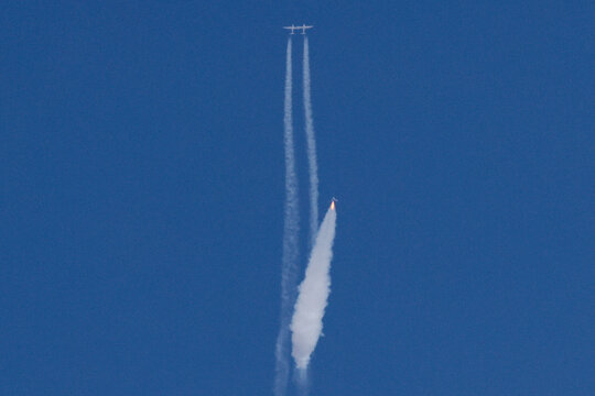 Virgin Galactic's passenger rocket plane VSS Unity begins its ascent to the edge of space above Spaceport America