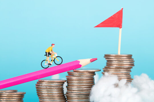 The model of the rider on the bike rides on a pencil carried on a coin
