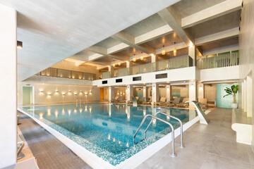 Fototapeta Indoor swimming pool in hotel wellness center obraz