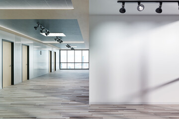 Obraz Blank wall in office mockup with large windows and sun passing through 3D rendering - fototapety do salonu