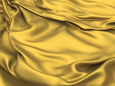 Golden fabric silk background.  Yellow satin wavy texture
