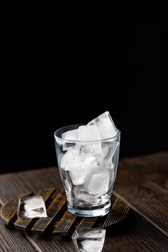 Ice cubes in crystal cup for preparing perfeshmetn recipe concept.