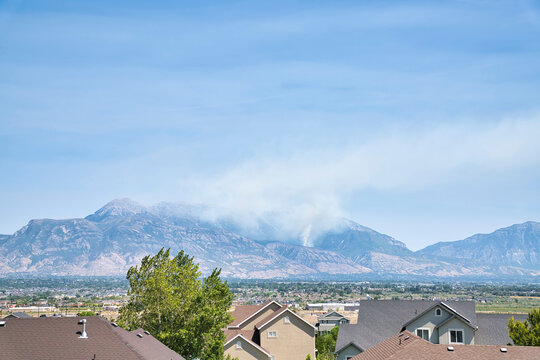 Smoke from wildfire in the Wasatch mountains senn from houses in Utah Valley