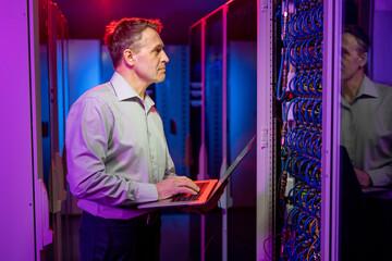 Fototapeta Network Engineer Performing Security Check obraz