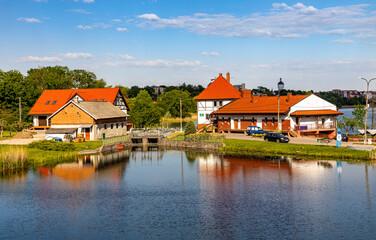 Obraz Ponds and reservoir facilities of traditional masurian fishing farm in Elk town of Masuria region in Poland - fototapety do salonu