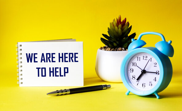 We are here to help, text on notepad and yellow background, business concept background