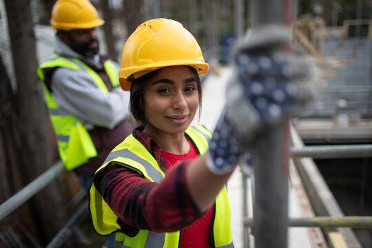 Portrait confident female construction worker at construction site