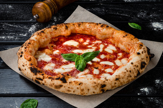 true Italian Pizza. Traditional Pizza Margherita with fresh mozzarella and basil