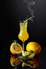 Fototapeta Traditional homemade lemon liqueur limoncello on the black background. obraz