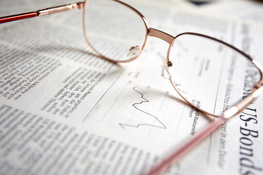 eyeglasses on the newspaper pages