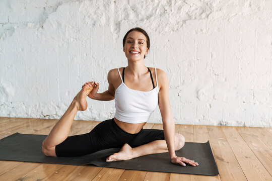 Young white sporty woman exercising