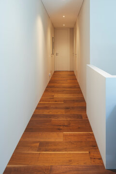 White hallway with spotlights in a stylish modern home. White walls, perfect for your text