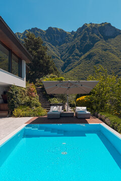 Modern two-story house with large pool overlooking the mountains. Nobody inside