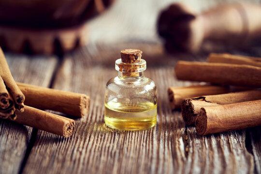 A bottle of aromatherapeutic essential oil with Ceylon cinnamon sticks