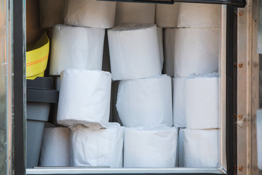 Individual Rolls Of Toilet Paper Are Stacked In Supply Truck