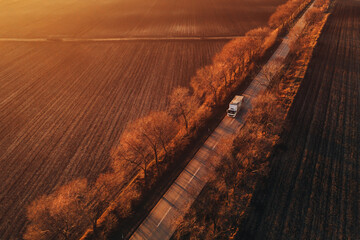 Obraz Aerial view of semi-truck on the road in sunset, drone pov - fototapety do salonu