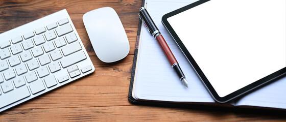 Obraz Mock up digital tablet, notebook and keyboard on wooden desk. - fototapety do salonu