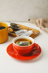 Fototapeta Cup with tea bag on light background obraz