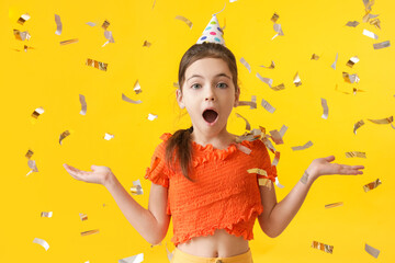Cute little girl celebrating Birthday on color background