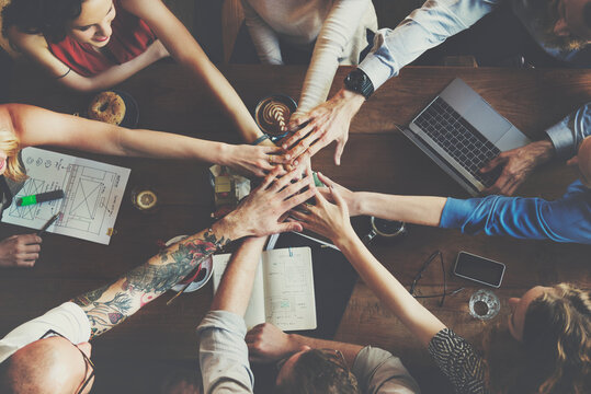 People are joining hands together as a teamwork