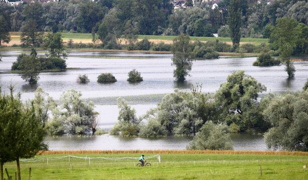 The landscape flooded by the Lorze River is seen near Maschwanden