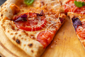 Pizza Margherita on wooden board close up