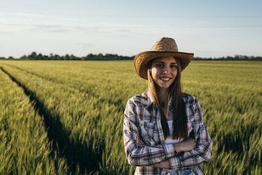 woman farmer standing in wheat filed