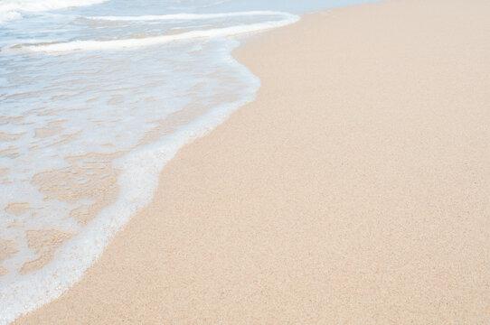 Soft sea wave on clean sandy beach