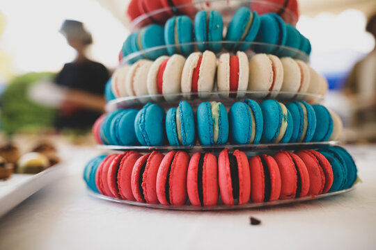 Shallow depth of field (selective focus) details with macarons on a table.