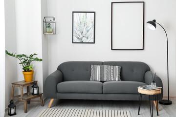 Fototapeta Interior of stylish living room with comfortable sofa obraz