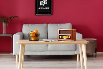 Fototapeta Interior of stylish living room with retro radio receiver obraz