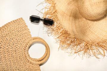 Fototapeta Stylish hat, bag and sunglasses on light background obraz