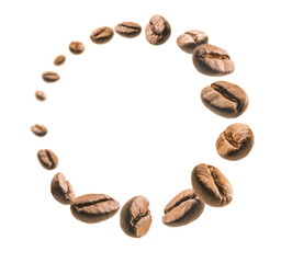 Coffee beans levitate on a white background