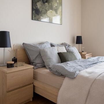 Comfortable bedroom with two wooden nightstands