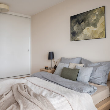 Bright bedroom with king size bed and wardrobe