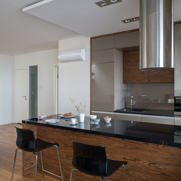 Kitchen island with black countertop in small kitchen