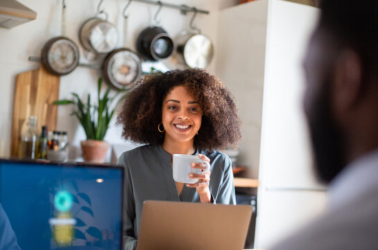 African American couple working from home having coffee
